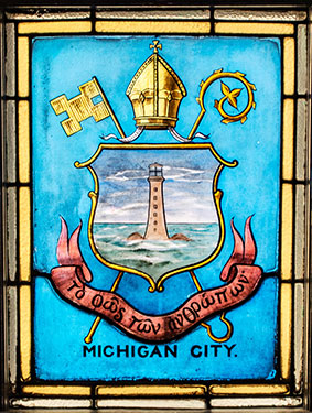 Stained glass of a lighthouse in the lake to designate Michigan City.